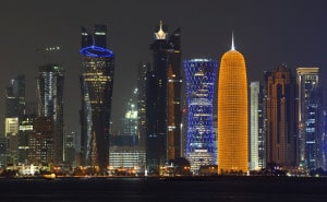 Mandatory Credit: Photo by imageBROKER/REX/Shutterstock (2741434a) Skyline of Doha at night with the Al Bidda Tower, Palm Tower 1 and 2, the World Trade Center, Tornado Tower and the Burj Qatar Tower with golden illuminations VARIOUS